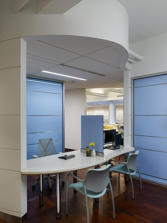 Discreet registration and care coordinator zones ensure patient privacy and dignity at each encounter.