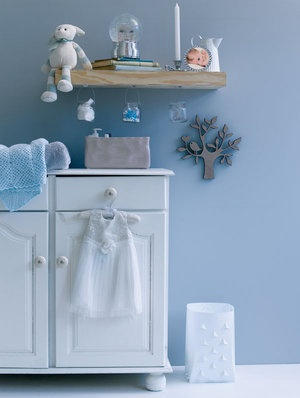 At the changing table, hang glass containers from a floating shelf, and stick down any containers on the table that could easily be knocked over... Storage solutions | Pretty ideas | YourParenting