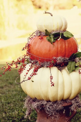 Could paint the pumpkins black and pink to match color scheme