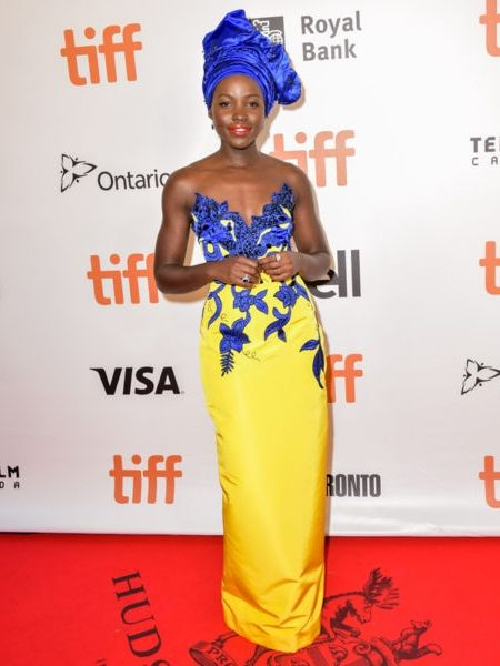 Lupita Nyong'o looked totally stunning in a bright and cheery yellow and blue dress on the red carpet at the Toronto Film Festival.