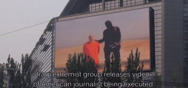 Footage of executed US journalist James Foley shown on giant TV in downtown Beijing on repeat loop -