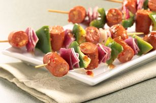 Italian Dog Kabobs recipe -  55 These no-grill kabobs are made with cheddar-stuffed beef franks, red pepper and green onion, then brushed with Italian dressing before going under the broiler.
