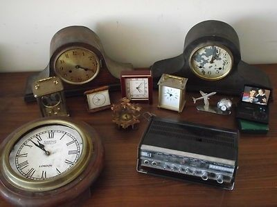 A Job Lot Of Vintage Clocks & A Radio A lot of old clocks, comprising: New Haven mantle clockUnnamed wooden mantle clock Smiths Enfield wall clock Small cuckoo type clock Swiza Manhatten desk clock V