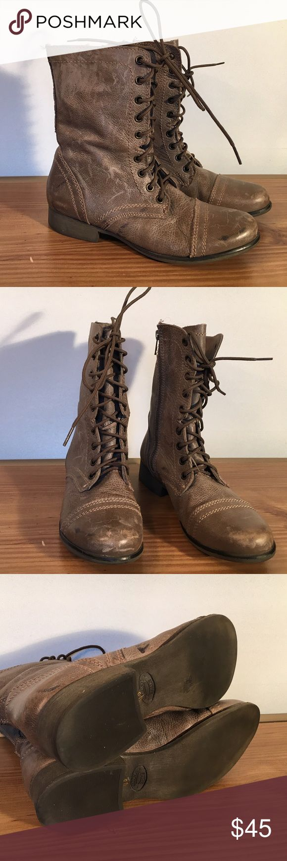 Steve Madden Troopa boots Steve Madden taupe colored distressed combat boots. These have some darker markings on the right boot as shown in cover picture..but these marks don't look out of place on this particular boot Steve Madden Shoes Combat & Moto Boots