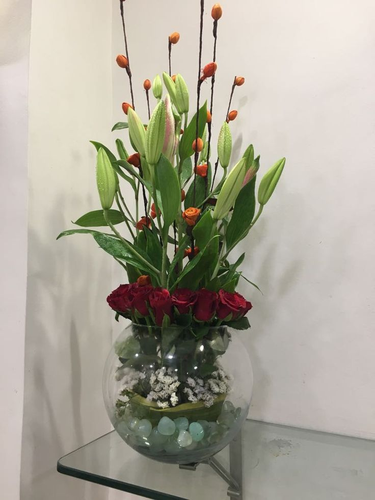 Send a beautiful bouquet of rich red roses and pure lilies wrapped and ready to be displayed in a vase. Order flowers and gifts including Red Roses & Lilies - Globe of Love from bloomsonly.com. For more details about beautiful flower arrangements visit blooms only Website -   https://www.bloomsonly.com/