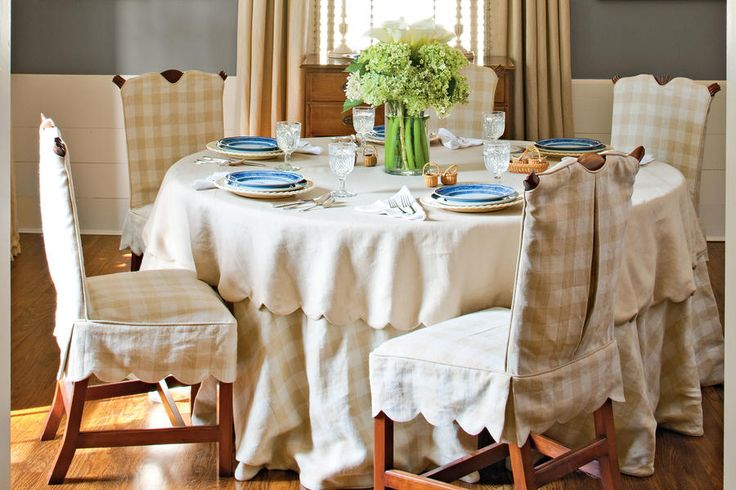 Soften the Space with Linens - 79 Stylish Dining Room Ideas - Southernliving. Simple details like the finish of your linens help set the tone of your dining space. This round table and antique chairs are covered in simple linen and checked fabrics. A dainty scalloped edge on the chairs and table topper adds a decorative touch.  See this Cape Cod Cottage Makeover