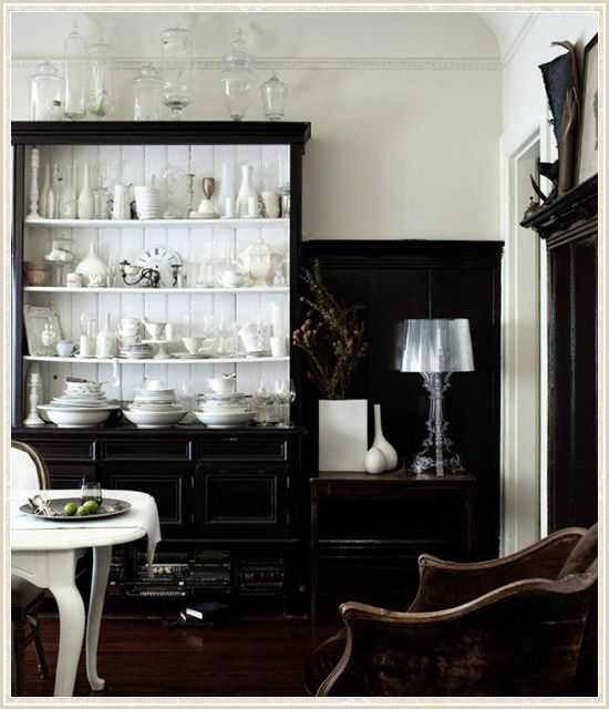 Love so much about this room. Especially the high level where wall paint changes from black to white; the hutch with black exterior/white beadboard interior; the collections; the white dining table against all that black. A beautiful study in contrasts.