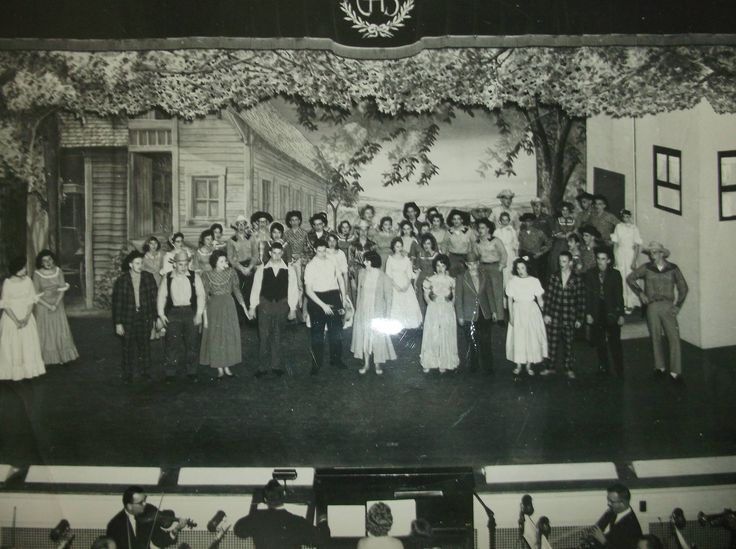 """This is a photo taken by a Pottsville Republican newspaper staff photographer of the 1961 Pottsville High School Auditorium combined choirs production of """"Oklahoma."""" For many of us, being in the cast and performing this show was our ultimate high school experience."""