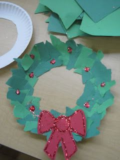 Just cut the center out of a paper plate, grab some different shades of green construction paper, some glue, and some glitter. Kids rip pape...
