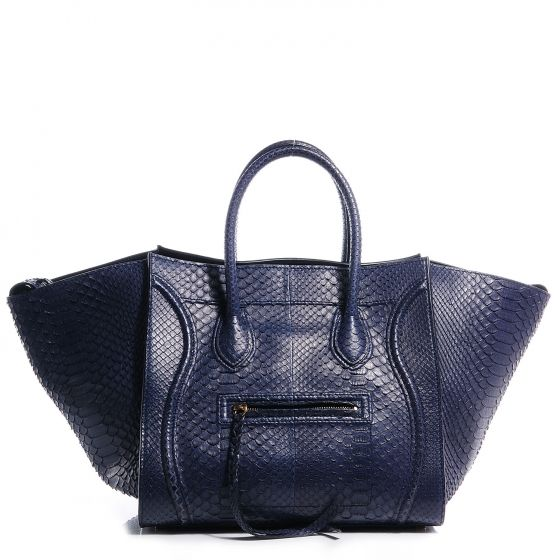 This is an authentic CELINE Python Small Phantom Luggage in Navy ...