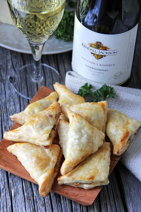 These bite-sized Mushroom, Herb and Gruyere Cheese Mini Turnovers will disappear from your appetizer table before you know it. #recipe: