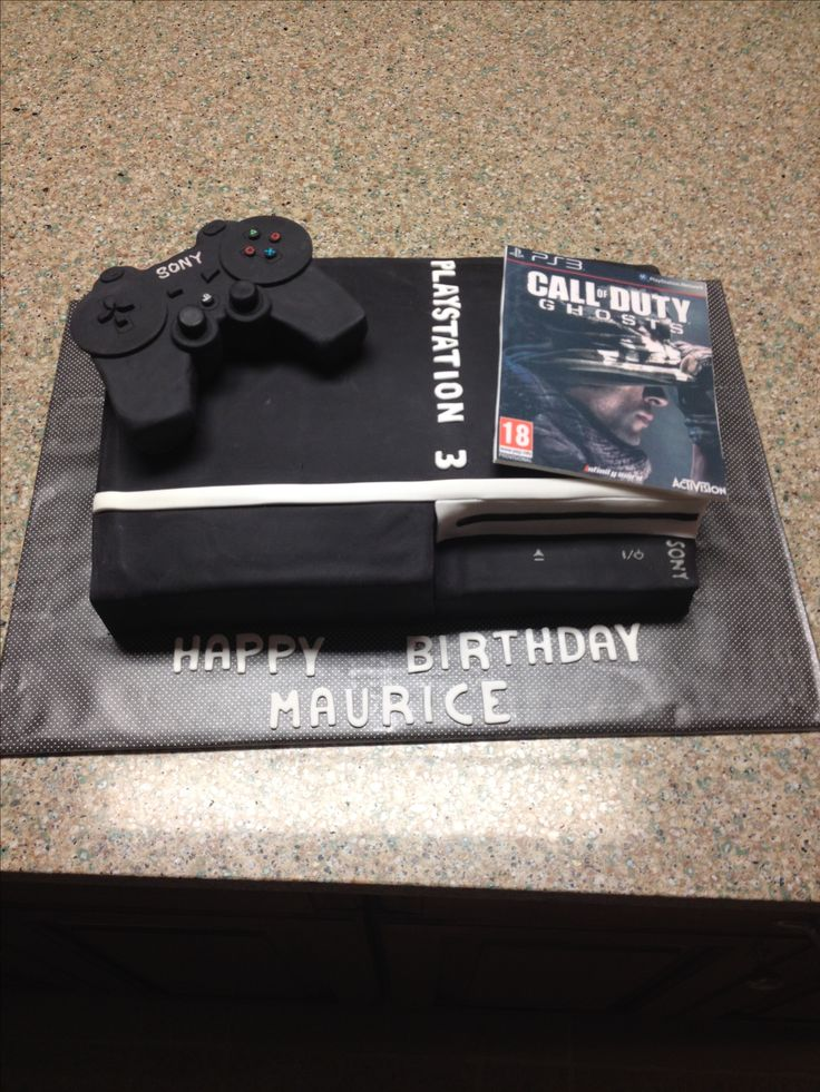 Playstation 3 cake with edible image of COD Ghosts game.