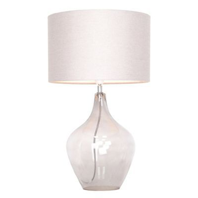 This 'Highgate' table lamp is a clean, elegant piece for brightening up any room of the home. Its understated design is crafted with a smoked glass base and a simple cream shade.