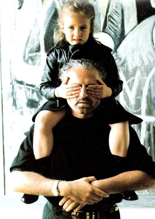 Gianni with his niece, Donatella's daughter, Allegra. In his will, Gianni left Allegra with 50% of the company stock. She always looks so sad nowadays!