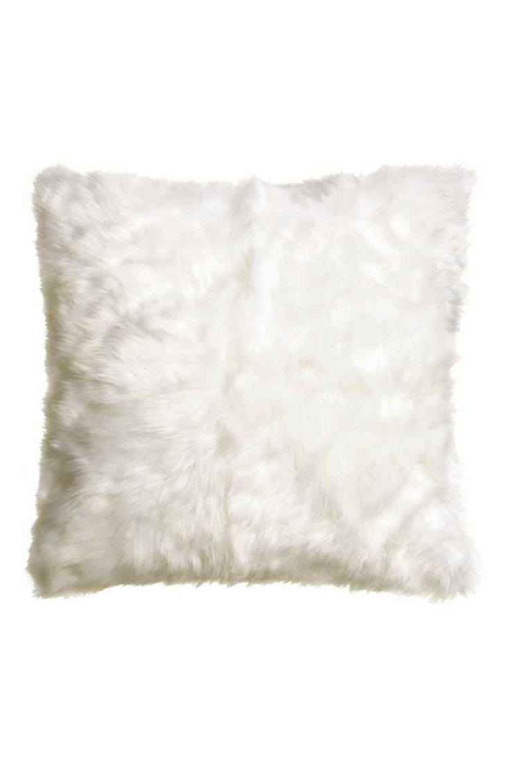Faux fur cushion cover: Faux fur cushion cover with a woven cotton backing and concealed zip.