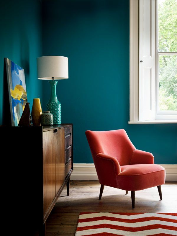Teal living room with coral pink velvet chair