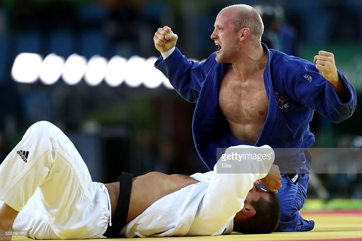 Marcus Nyman of Sweden celebrates against Alexandre Iddir of France during a Men's -90kg Repechage bout on Day 5 of the Rio 2016 Olympic Games at Carioca Arena 2 on August 10, 2016 in Rio de Janeiro, Brazil.