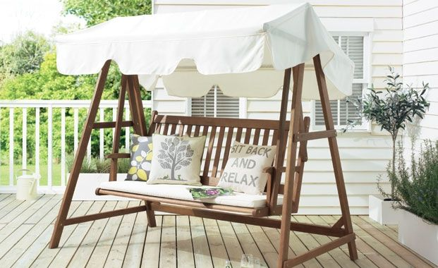 Relax in the garden in a swing seat for two. (Windsor wooden swing seat by Tesco)