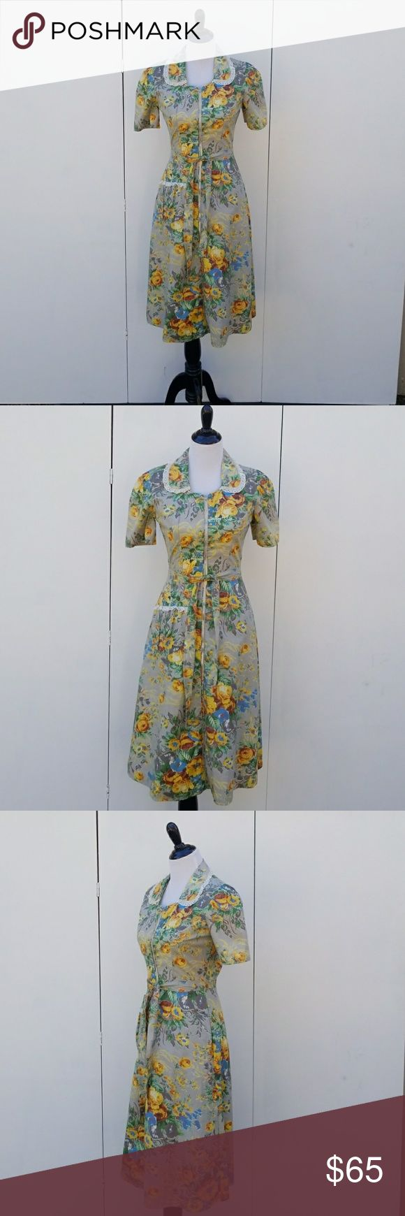 "Vintagr 40's Gray & Yellow Floral Cotton Dress In Pristine Condition. This amazing dress from the 1940's features princess darting, rounded collar, built in tie around belt, front pocket, front zip, full skirt, puckered sleeves and lace trimming. Gray with yellow floral pattern.  the measurements are bust 36"", waist 26"" , hips up to 40"", length 46"" from back of nap. Vintage Dresses Midi"