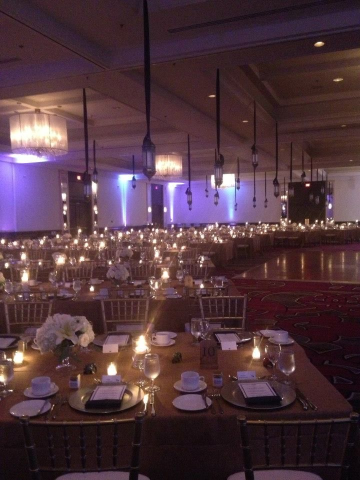 Take inspiration from this gorgeous Mediterranean themed reception complete with a sea of candles, charger plates and chiavari chairs.  The ultimate elegance!  Venue: Grand Ballroom.  Decor: Weddings and Events Designed by Sylvain (W.E.D.S.)