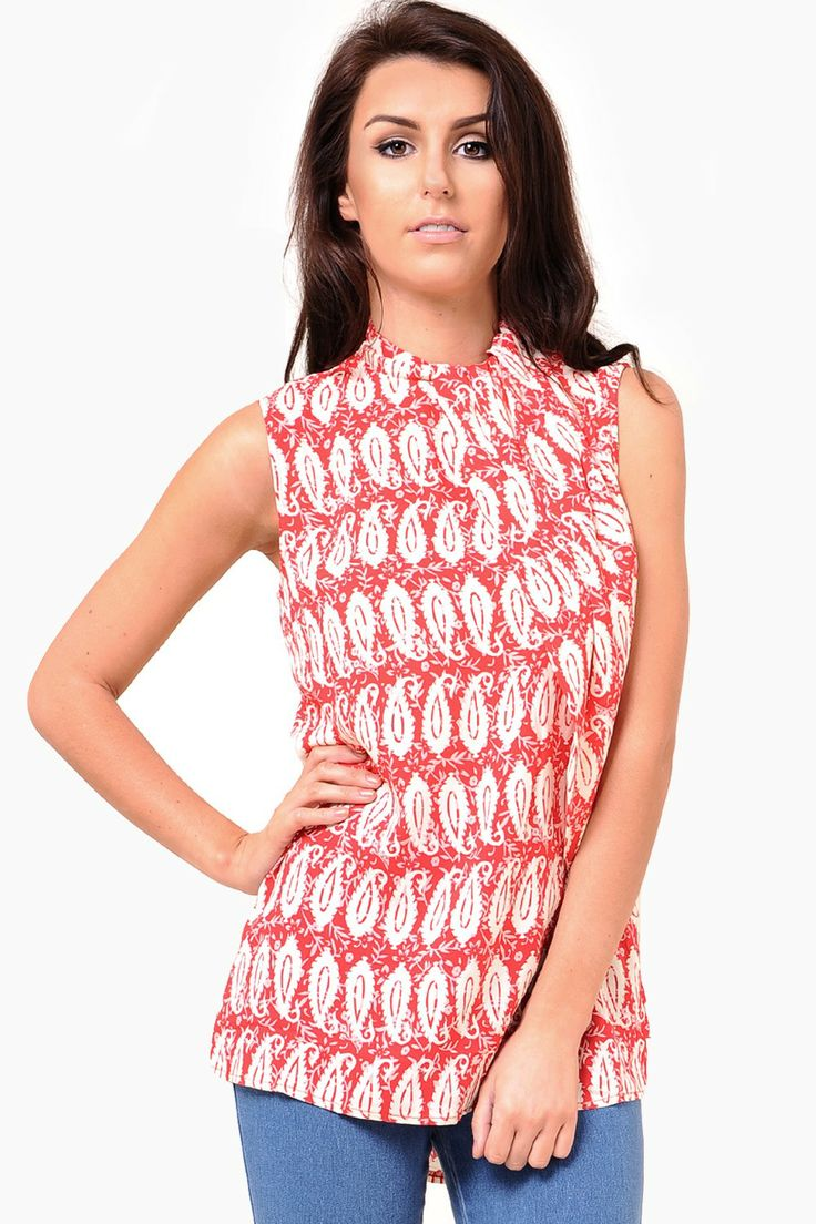 This graphic print top is a wardrobe staple. Perfect worn with skinny denim jeans or tucked into a high waist skirt with a pair of killer heels.  - Pleated wrap neck detail - Hi-low dip hem back  - Sleeveless styling  - High neck - Exposed zip