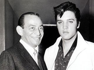 Sy Devore moved to Los Angeles from New York to open a 900-square-foot shop at the glamorous intersection of Sunset Boulevard and Vine Street, in Hollywood. The shop, which sold handmade custom suits, was next to Wallichs Music City and down the street from the world-famous Brown Derby restaurant. He dressed Elvis wonderfully