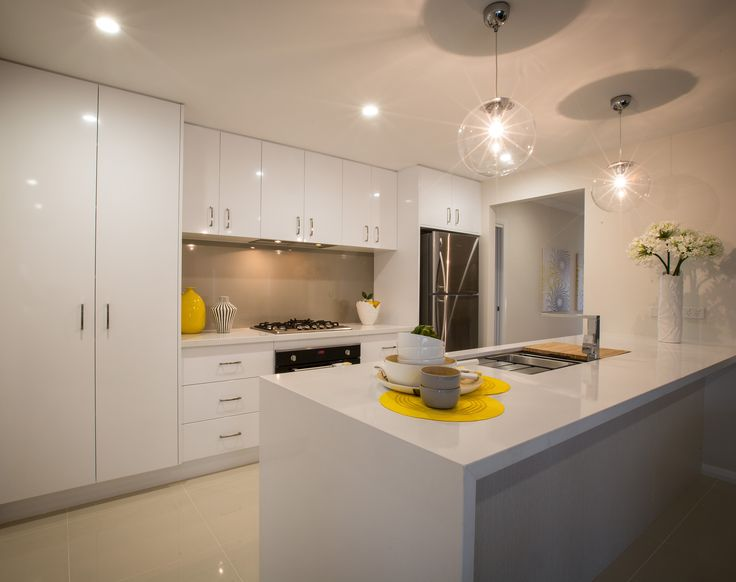 Love the neutral colours in this kitchen topped off with gorgeous pendant lights! #kitchen