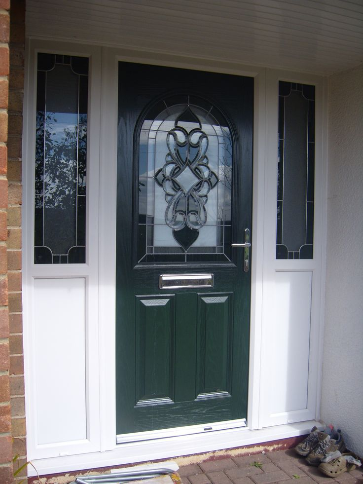 A green composite door with large crystal design and 2 sidelights
