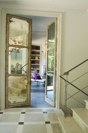 Antique mirror doors.  Makes me wonder if I can use antique doors and make the glass look like mercury glass.
