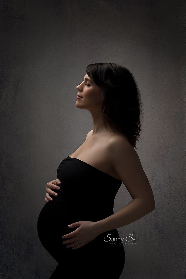 Gorgeous dramatic soft lighting for this studio maternity photography shoot. Simple black gown. Sunny S-H Photography Winnipeg