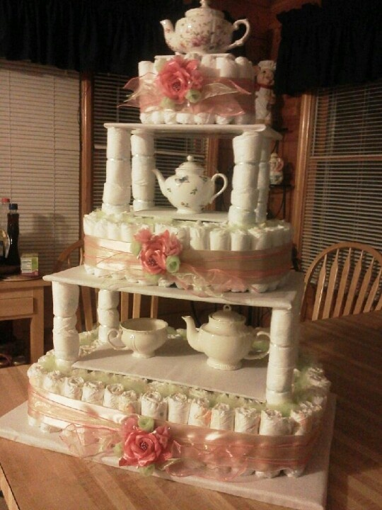 Tea party diaper cake. I like this tiered idea ! Not crazy about teapots , I'm thinking flowers in between layers !