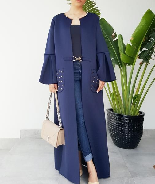 Thia elegant neoprene abaya in dark blue is accented with gold metal trim on the neckline and metal studs on the pocket. Flaired sleeves and deep pockets make this abaya perfect for teh day or evening especially good for travelling in. Super comfy, light weight and very elegant yet sporty! length standard 55