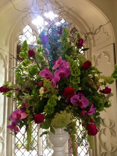 Wedding flowers - pedestal arrangement at Cliveden House. Lime green and cerise orchids