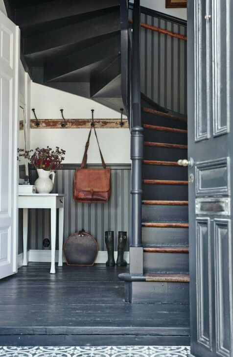 grey floor, grey door, grey stairs with wood treads