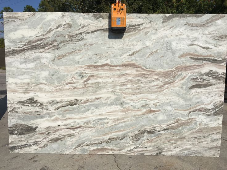 #FantasyBrown #granite is a beautiful natural stone, a perfect #granitecountertops slabs for light and dark #kitchencabinets. Nice variation in stone looks like waves of ocean with nice beige background in slab which can go with any #kitchenisland.