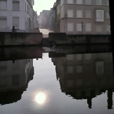 Ian Ledward. I love his reflections - makes me want to touch the water!