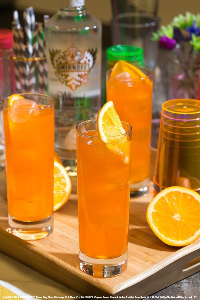 Creamy Orange with 2 oz SMIRNOFF® Whipped Cream Flavored Vodka, 4 oz orange soda and 1 orange wedge. Mix ingredients in a cocktail shaker and serve in a glass with ice. Garnish with an orange wedge. #Smirnoff #Drink #Recipe #Spring