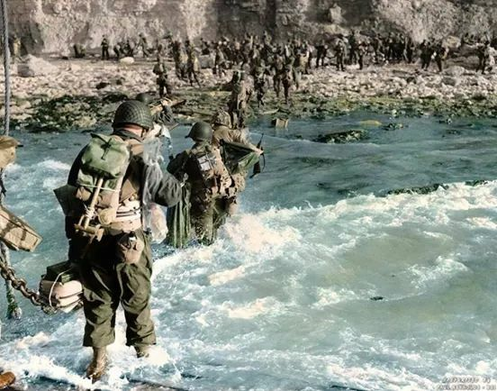 Troops of the 5th Engineer Brigade wade through the water on Omaha Beach, Normandy