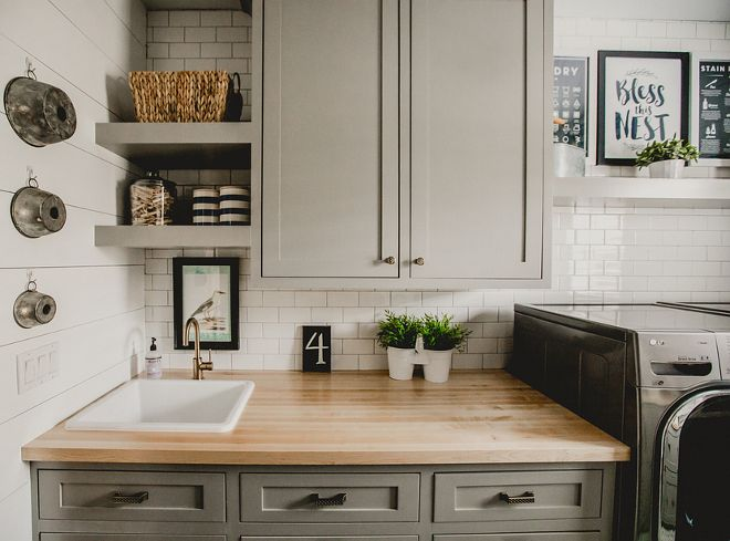 "Cabinet paint is ""Cape May Cobblestone"" by Benjamin Moore, Shiplap is ""Simply White"" by Benjamin Moore, Maple butcher block countertop, cabinet hardware from Home Depot."