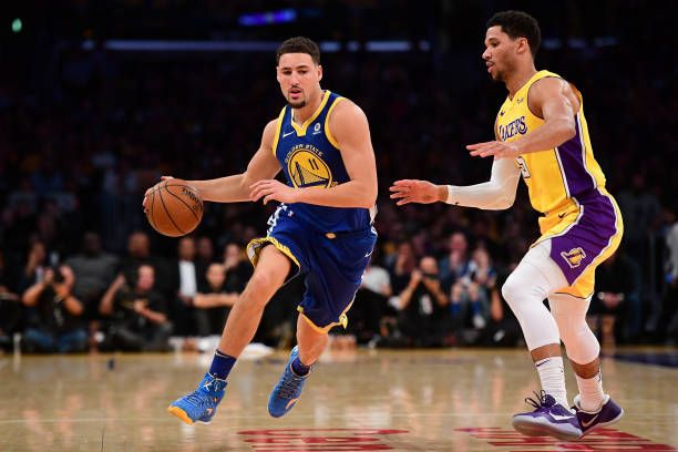 Klay Thompson of the Golden State Warriors drives on Josh Hart of the Los Angeles Lakers in the first half at Staples Center on December 18 2017 in...