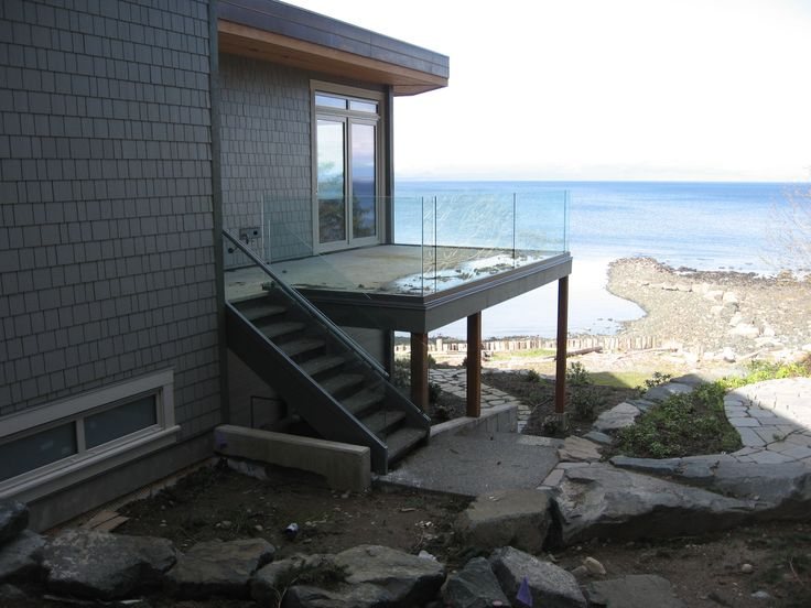 12mm tempered railing glass with concrete deck.