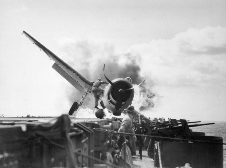 Crash landing of a Hellcat on USS Enterprise, into the carrier's port side 20mm gun gallery, 10 November 1943.