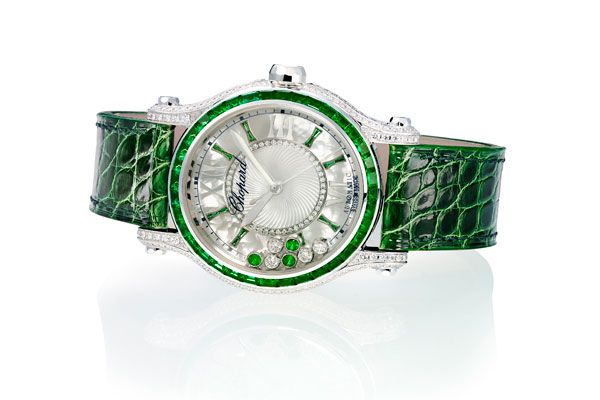 Chopard's Happy Sport Medium Automatic Joaillerie watch features a bezel, crown and hour markers set with  emeralds and matching alligator leather strap.