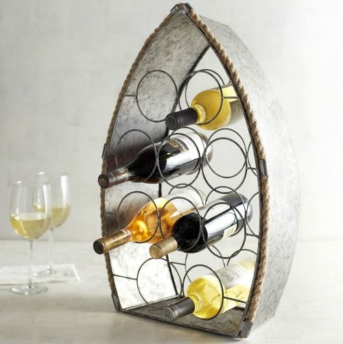 Boat Wine Rack $49.... http://www.completely-coastal.com/2016/03/wine-bottle-racks-coastal-nautical.html