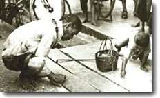 Japanese occupation of Singapore - old man and his grandson picking up rice grains that had fallen onto the road.  Every grain was precious.  (http://www.cofepow.org.uk/pages/asia_singapore_rise_and_fall.htm)
