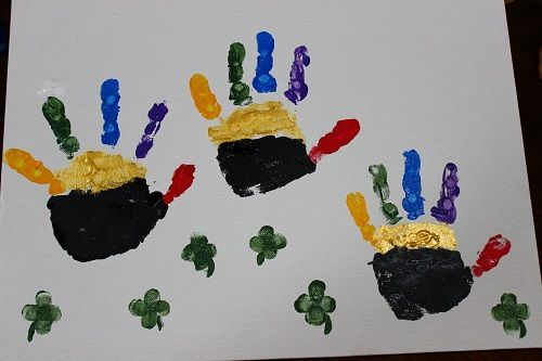 Little pots of gold under the rainbow made with handprints. Happy St. Patrick's Day!