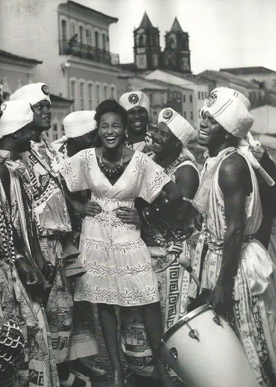 """This photograph is from one of many fashion editorials set in Salvador da Bahia, Brazil; the gentlemen wearing turbans are dressed as members of a popular afoxé called Filhos de Gandhy, or """"Sons of Gandhi"""""""