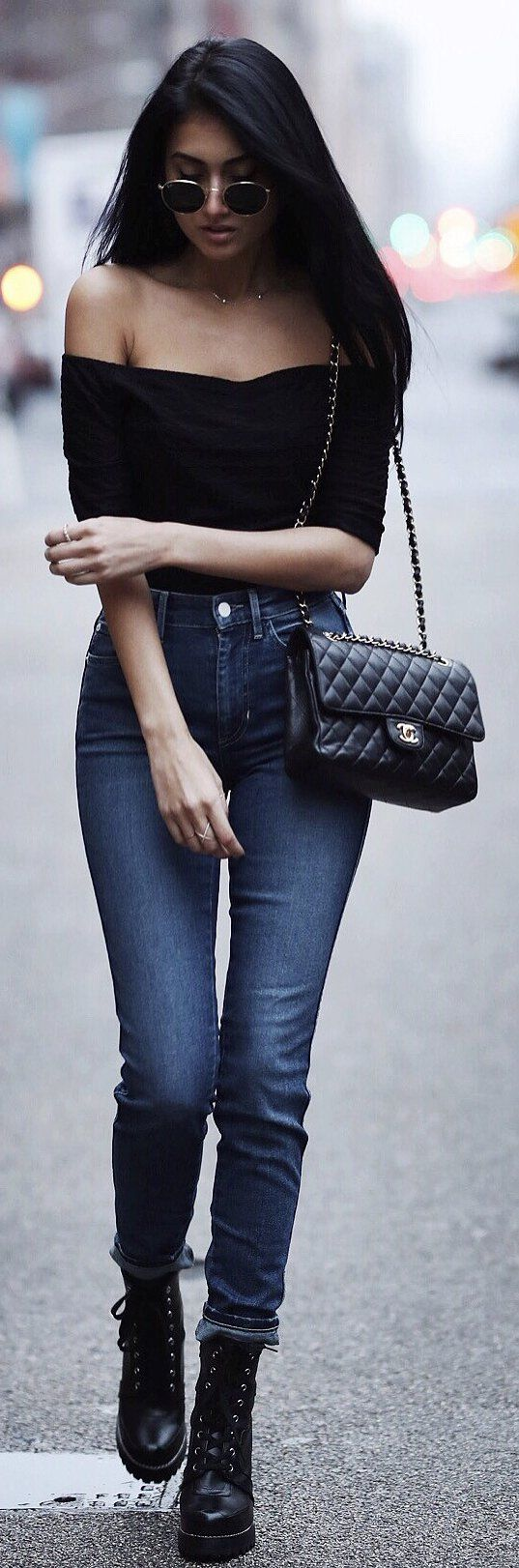 Black Off Shoulder Top / Black Quilted Shoulder Bag / Navy Skinny Jeans / Black Leather Booties