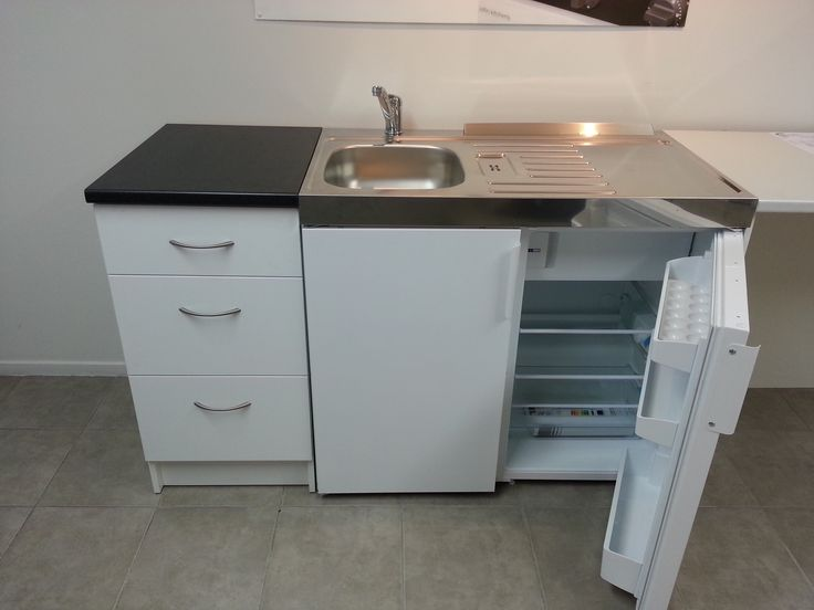 Elfin Original Kitchenette aside a 3 draw unit with Formica benchtop.