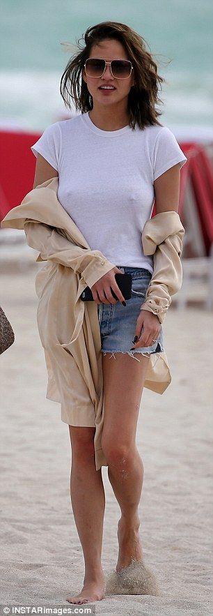 Chrissy Teigen wears revealing white top #dailymail
